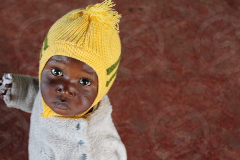 baby in yellow knit cap photo