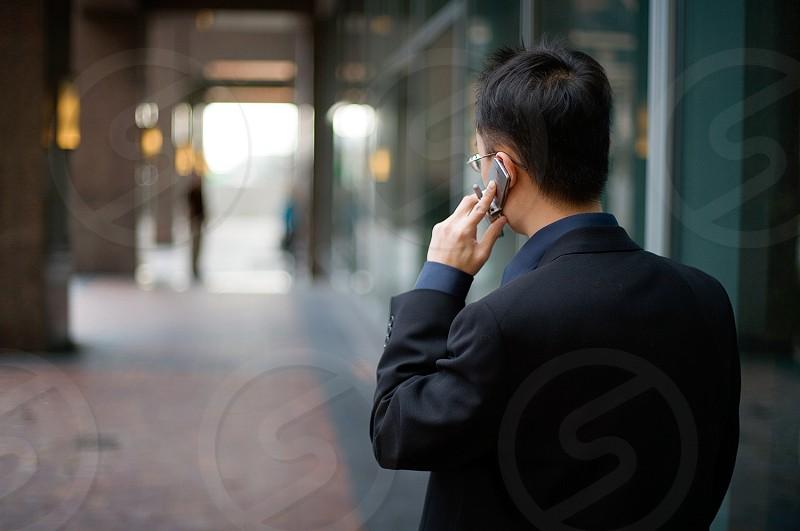 man speaking on mobile phone photo