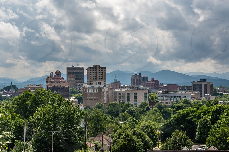Asheville North Carolina Western Looking from East to West Mountains Stormy Skies Neighborhood in foreground  photo