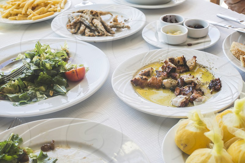 Octopus in a Greek restaurant. White table. Greece Athens Piraeus photo