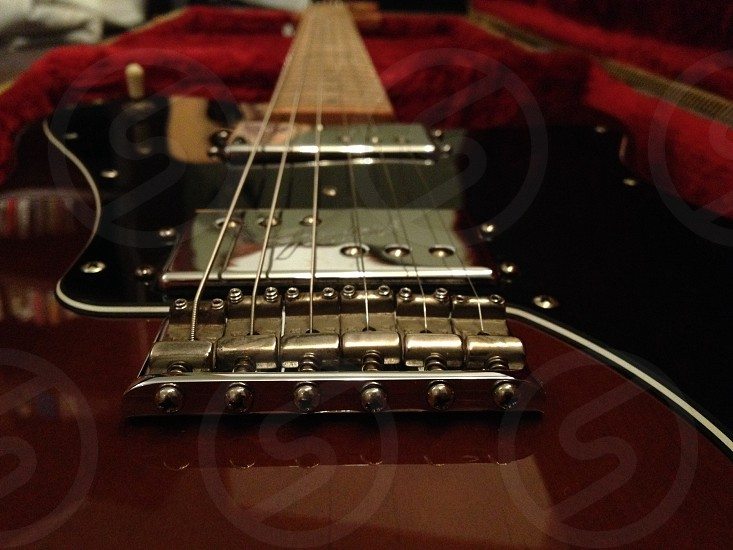 red and black electric guitar photo