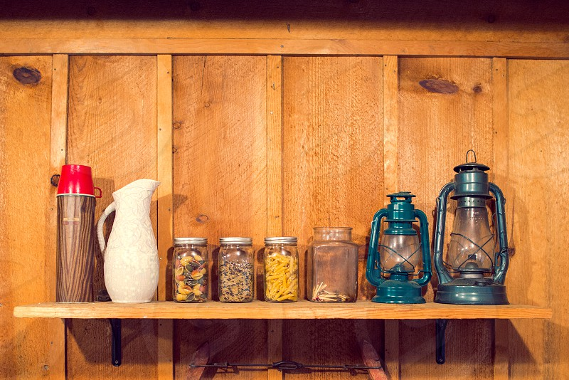 cabin kitchen old fashioned wood redwood cedar lanterns mason jars kitchen shelf photo