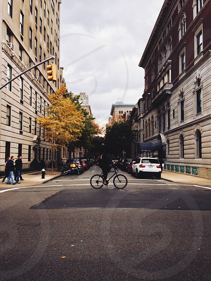 man riding bicycle on road photo