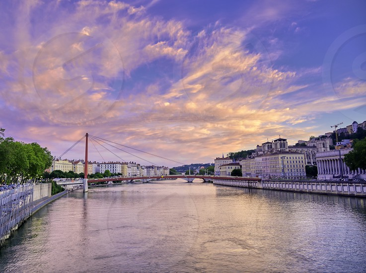 A view of Lyon France along the Saône river at sunset. photo