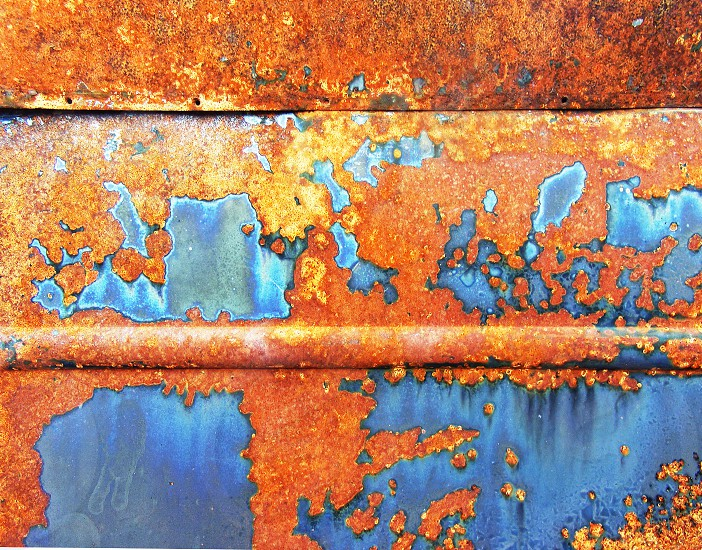Detail of a door on a rusted automobile. photo