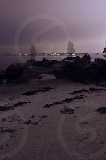 rock formation on seashore photography photo
