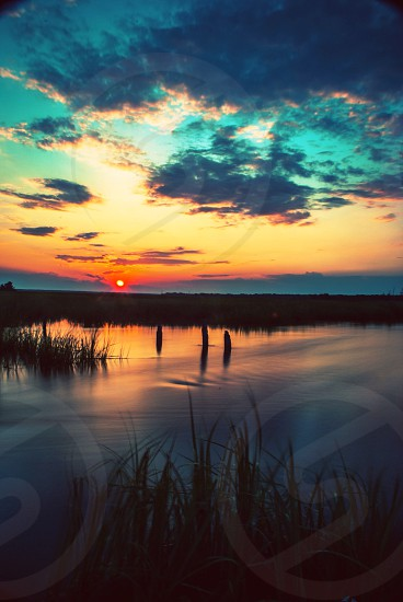 cloudy sunset over marshland photo