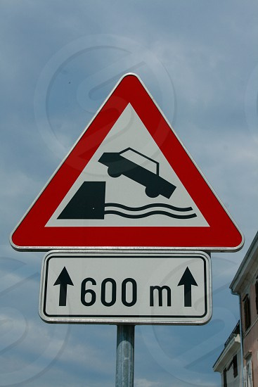 Driving caution sign at the edge of the port in Piran Slovenia. photo