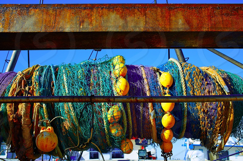 Trawler boat net rolled in its axis from Mediterranean port photo