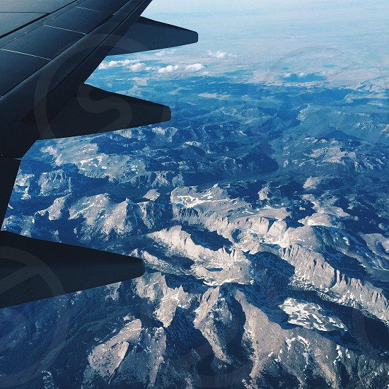 view of the mountain from a plane window photo