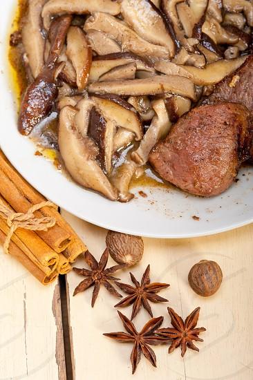 venison deer game filet tenderloin and fresh wild mushrooms  photo