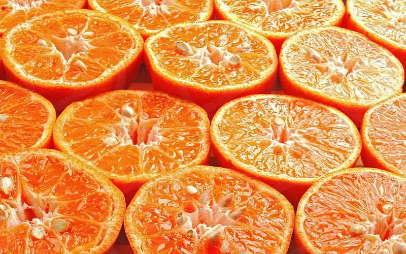ripe orange mandarine cutted in half  photo