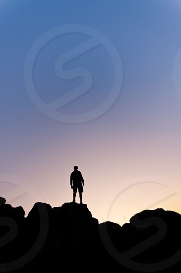 man boy young silhouette backlit climber climbing sport top mountain effort sky sunset sunrise photo
