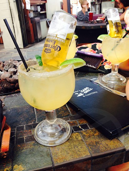 cocktail drink with Corona Extra beer bottle near black menu photo