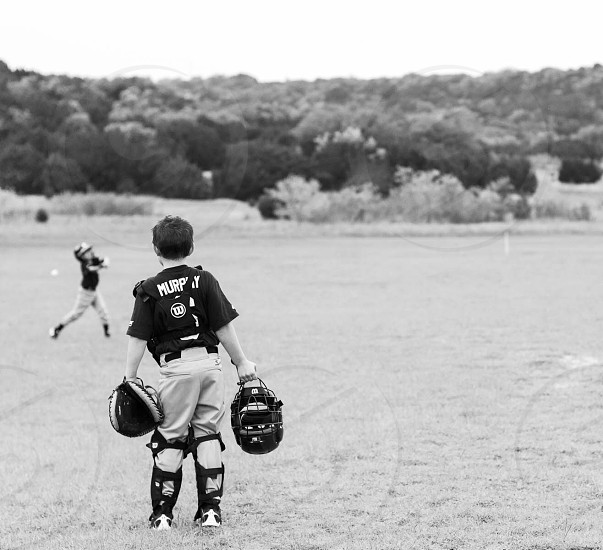 Childhood summer baseball catcher field central texas texas black and white photo