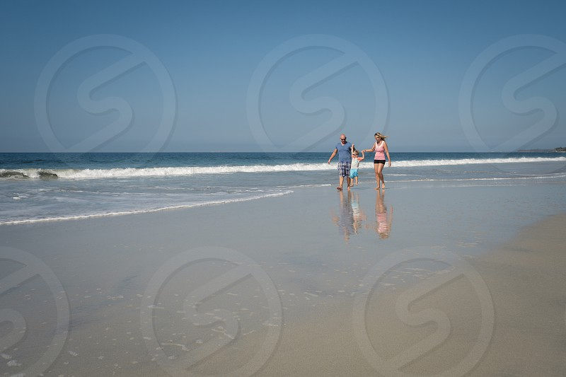 Caucasian family with toddler boy on the beach Riviera Nayarit Mexico photo