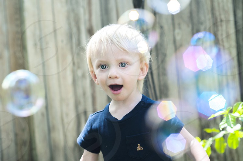 His sheer amazement for bubbles is beautiful 🌀 photo