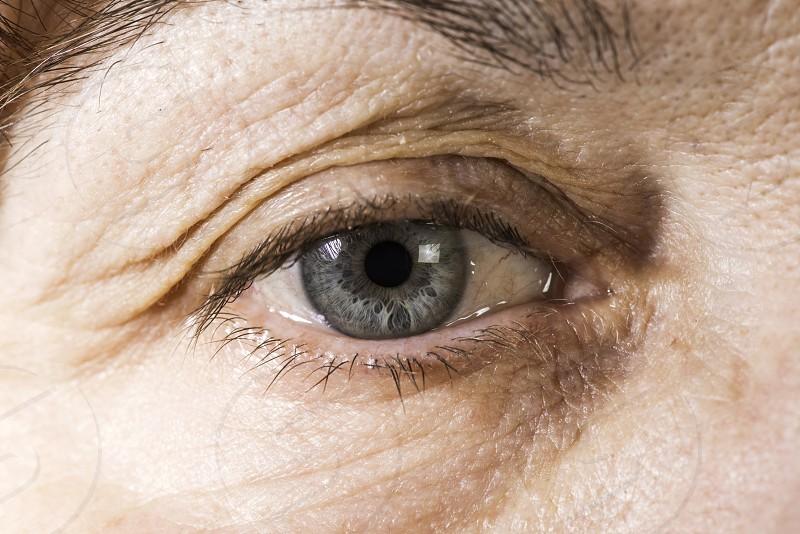 Close up old women blue eye photo