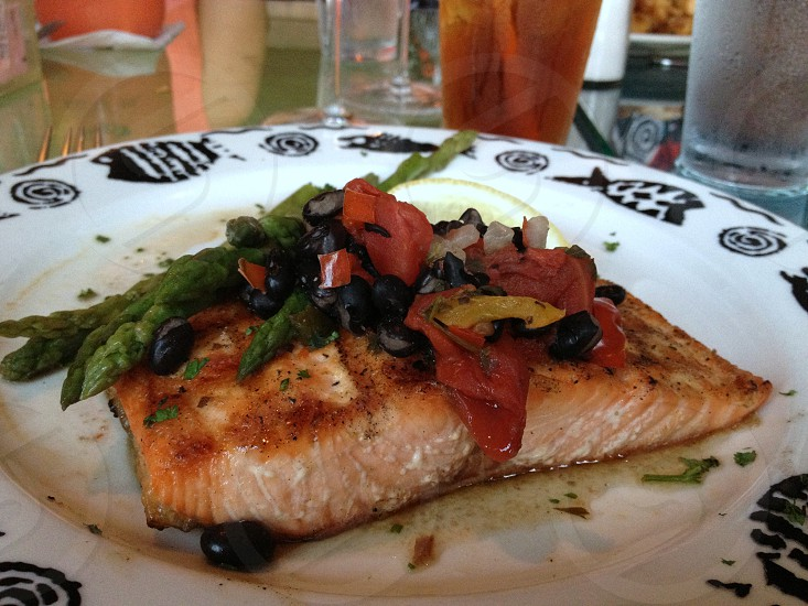 Salmon topped with red peppers black beans and asparagus photo