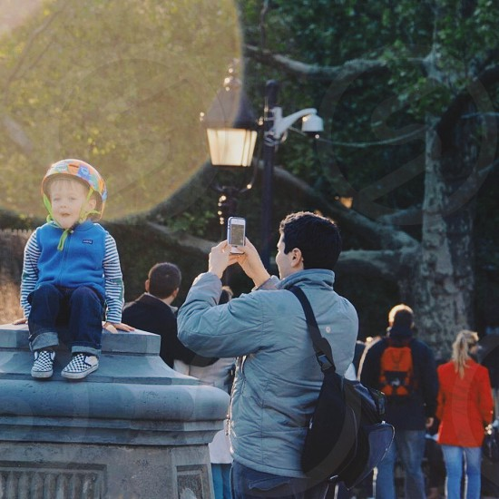 Father and son. Washington Square Park. NYC. photo