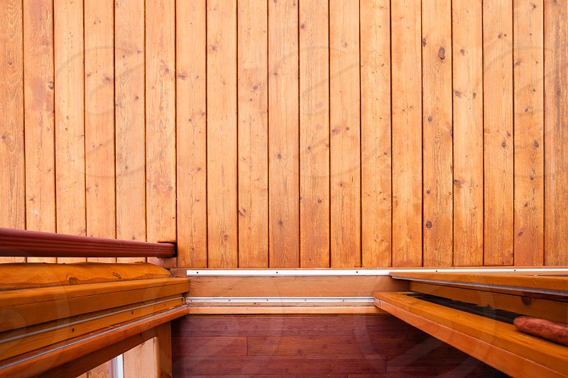 Sliding door open doorway onto wooden deck or porch from straight above with rich warm wood colors and textures photo