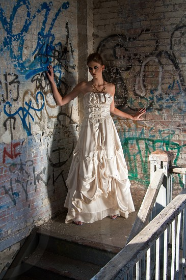fashion portrait model editorial face skin hair make up avant garde trendy hip female woman women glamour casual ethnic diverse demographic savvy tech modern bridal gown wedding demographic modern urban gritty street life city grungy edgy industrial steel rust metal weird wild mysterious odd freaky creepy strange photo