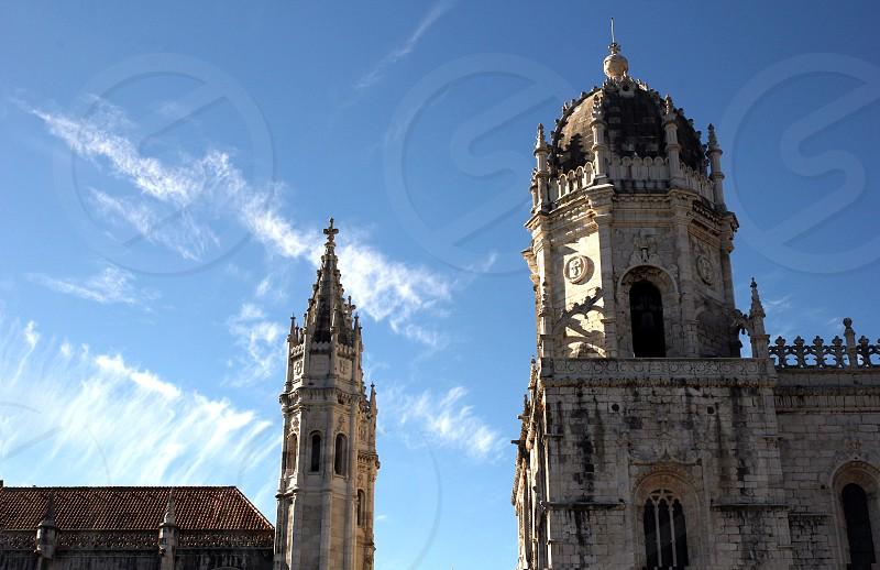 Belem Lisbon Jeronimos Monastery clouds sun bright light church photo