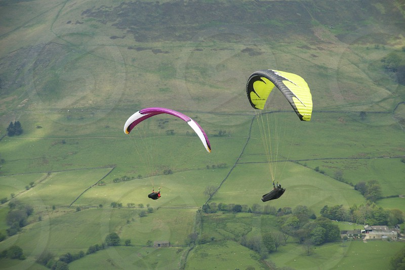 Paragliding over a sea of green. photo