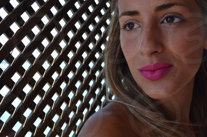 woman with pink lipstick photo
