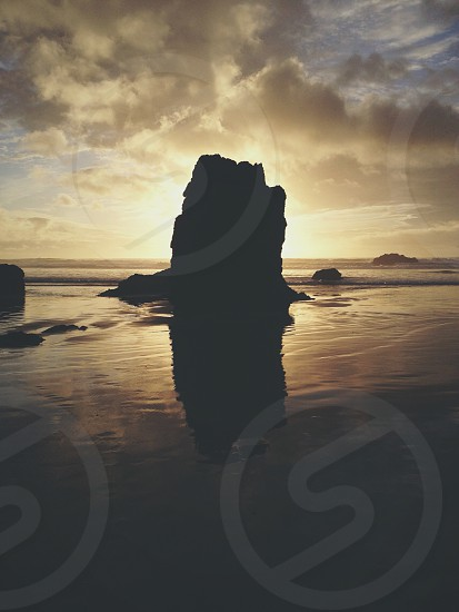 rock formation on sea photography photo