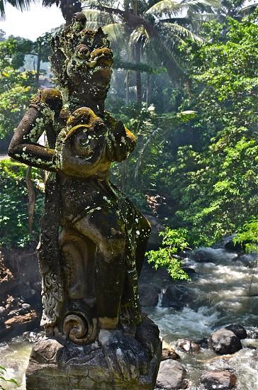 Bali bridge statue foggy exotic tropical adventure photo