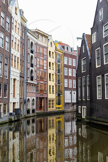 canal reflecting the buildings in amsterdam. color painted buildings photo