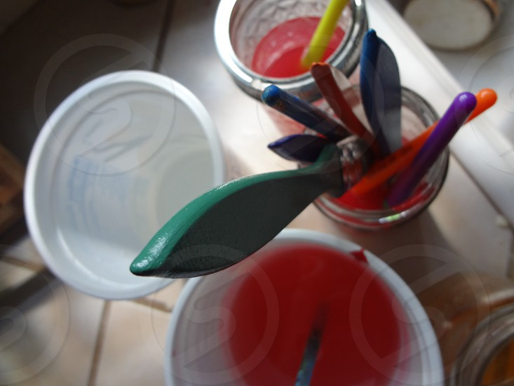 Colorful Paintbrush in Glass Jar photo