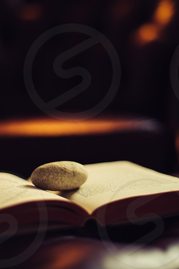 Open book with a stone on it. photo