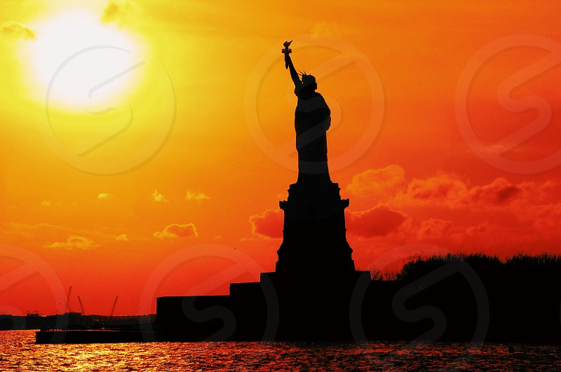 statue of liberty and sun photo