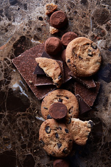 omemade chocolate candy and cookies on a marble background Drops photo