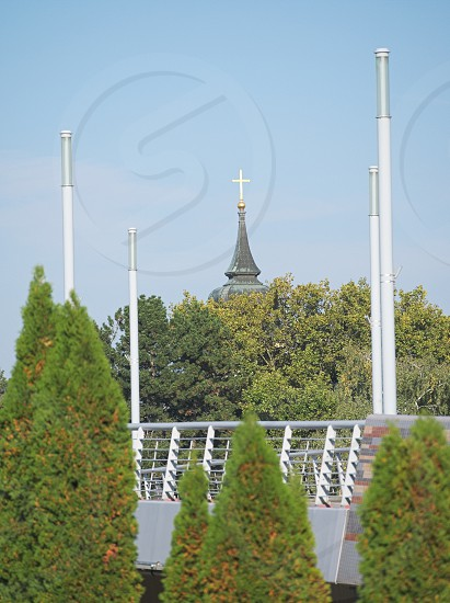Jedlik Bridge and Church Tower with Trees on a Sunny Autumn Day in Győr Hungary photo