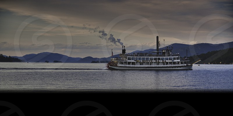 Shot of a steamboat on Lake George during sun set in the summer photo