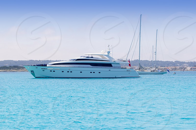 boats yacht and sailboats anchor in formentera illetas beach Balearic islands photo