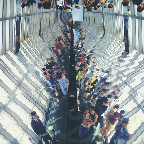 reflection of people in tunnel photo