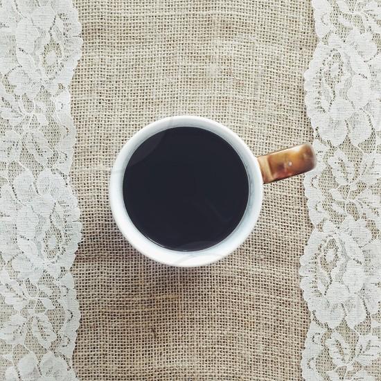 white ceramic coffee mug on brown surface photo