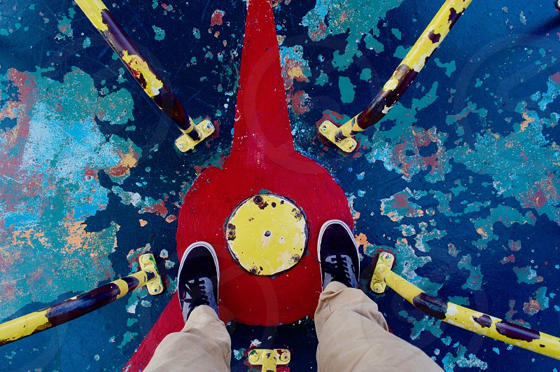 P.O.V of shoes on a playground toy. photo