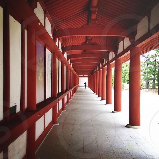 human walking on hallway photo