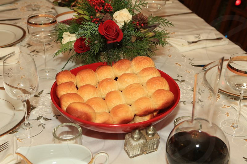 Our Daily Bread and wine.  Holiday table set with bread and wine. Wine decanter. photo