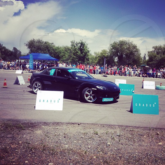 black sports coupe drifting on course during daytime photo