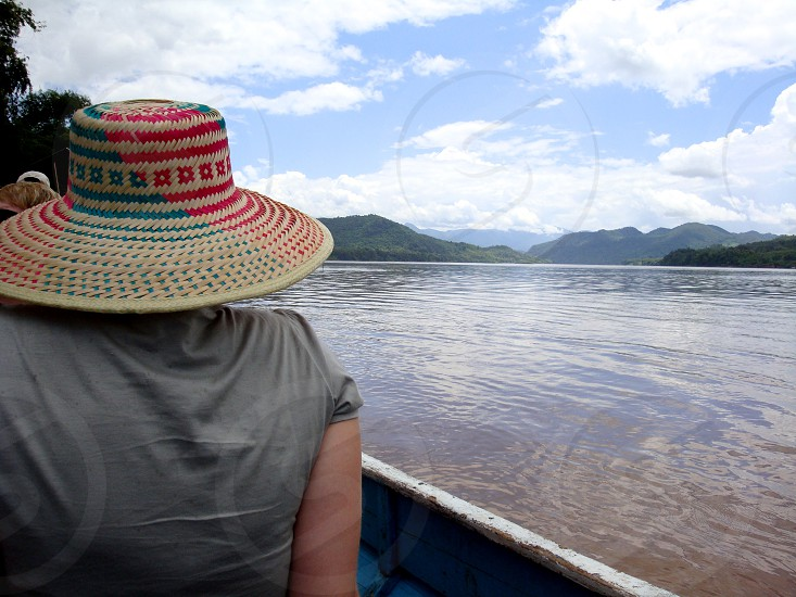 woman in grey t shirt riding boat photo