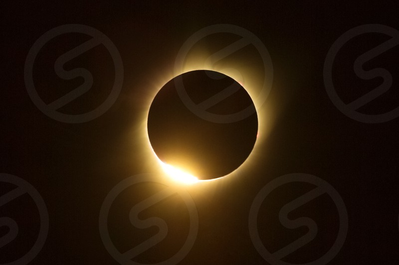 Totality of Great American Eclipse 2017 from Wind River area near Pinedale Wyoming showing diamond ring effect  or Baily's Beads. photo