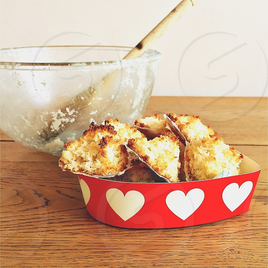 Coconut macaroons in a gift box with the mixing  bowl in the background  photo