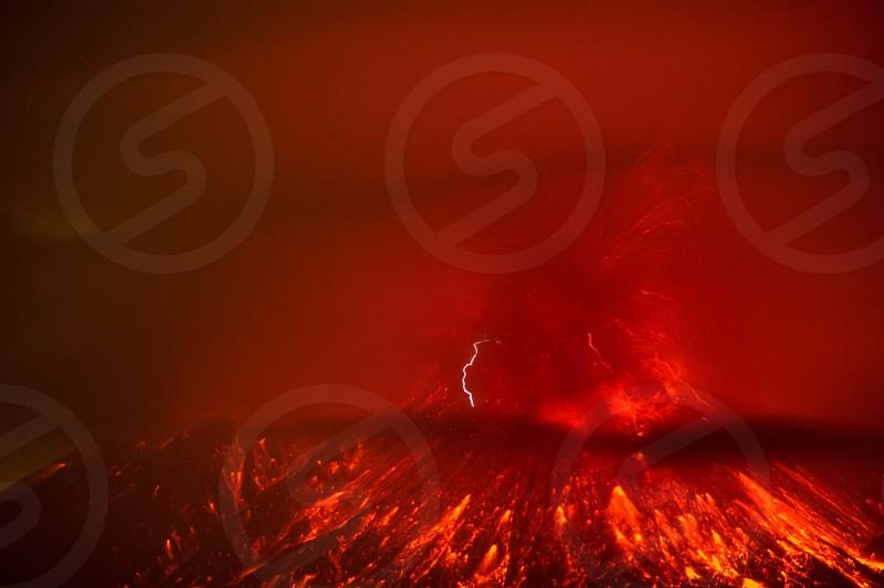 erupting red volcano photo