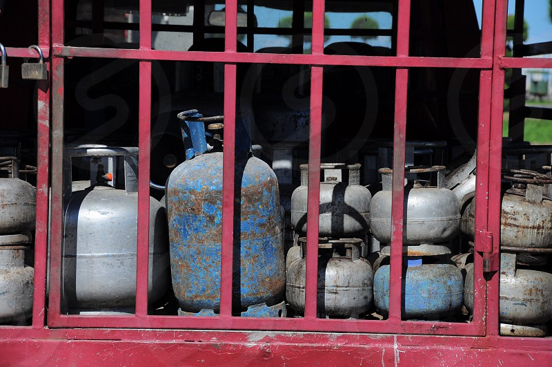 grey and blue propane tanks inside red track photo